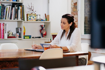 Businesswoman working on project in trendy office