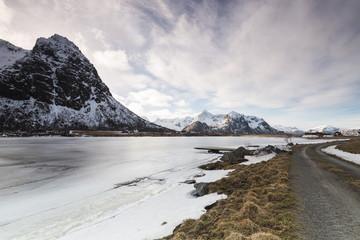 Rural road next to a frozen lake