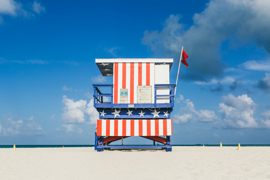 Lifeguard hut with United States flag decoration in South Beach, Miami