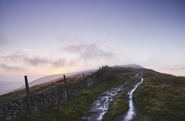 Mountain path and fence at sunset. Derbyshire, UK.