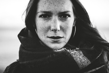 Portrait of a beautiful freckled woman by the seaside