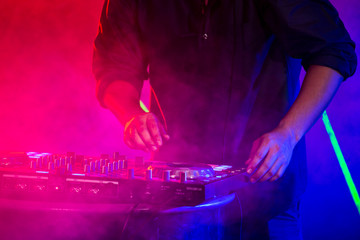 Closeup of Dj hand playing on turntable in nightclub,  People with party concept.