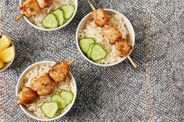 Asian style chicken skewers and rice. Healthy diet food concept.Top view