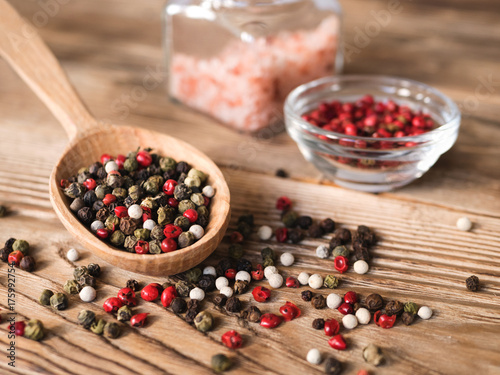 Mix Peppercorns In Wooden Spoon On Rustic Wooden Background Pink