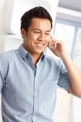 Portrait of Asian man on phone call