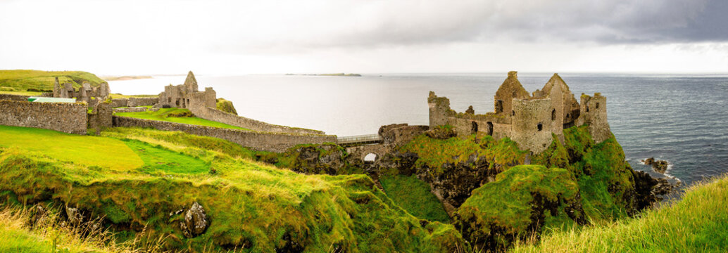 Dunluce castle in Northern Ireland, United Kingdom. Causeway coastal driving tourist route on the Emerald Island.