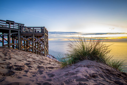 Summer Sunset Over Lake. Massive sand dunes and scenic overlook on Lake Michigan within the Sleeping Bear Dunes National Lakeshore on the Pierce Stocking Scenic Drive in Michigan.