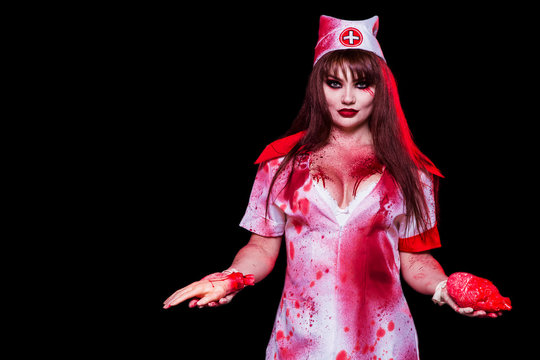A beautiful, sexy woman, a vampire, a nurse all in the blood, a cutout on her chest holding a human heart and hand. Sentence. Kill the killer, mania, cannibal