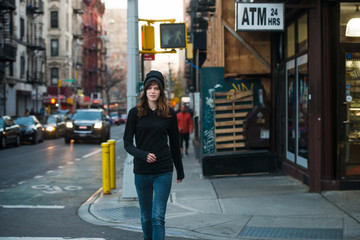Young woman walking on street in the city