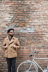 Man standing near his bike