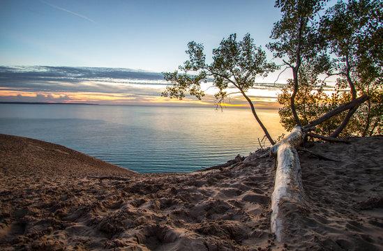 Sand Dune Overlook On Sunset Lake. Massive sand dune in Sleeping Bear Dunes National Lakeshore overlooking a sunset on Lake Michigan.