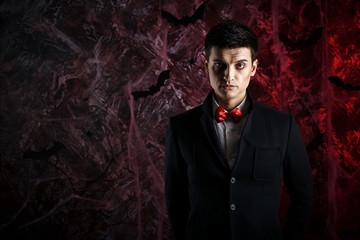 handsome man dressed in a Dracula costume for Halloween.
