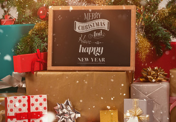 Chalkboard Surrounded by Christmas Gifts Mockup 1