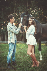 Young couple and beautiful horse
