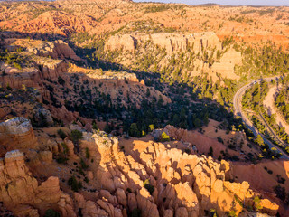 Beautiful orange Bryce canyon cliffs. Amazing aerial view from a helicopter.
