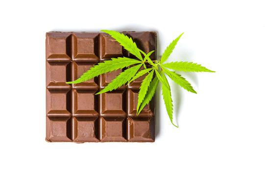 Chocolate block with marijuana leafs isolated