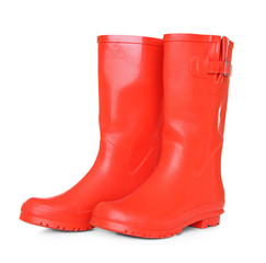 Red rubber boots on white background