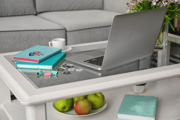 Comfortable workplace with modern laptop on table