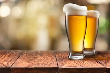 Two Glass of beer on wooden table