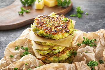 Delicious broccoli pancakes on table