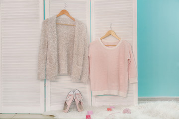 Wall Mural - Apricot sweater and beige cardigan on trendy folding screen