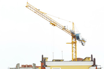 Construction crane and unfinished building, outdoors