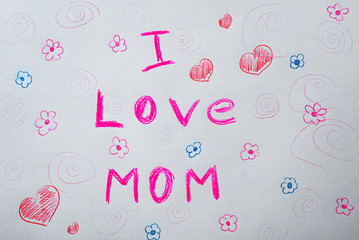 """Child's drawing with words """"I love mom"""""""