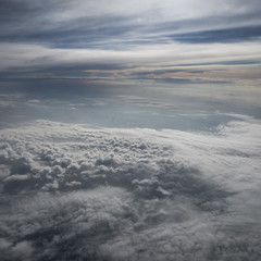 Beautiful clouds before sunset from the airplane cloudscape