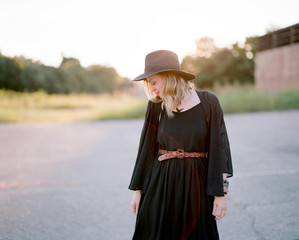 Beautiful and fashionable woman standing in an abandoned parking lot