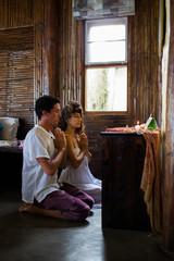 Couple Praying at the Altar at Home