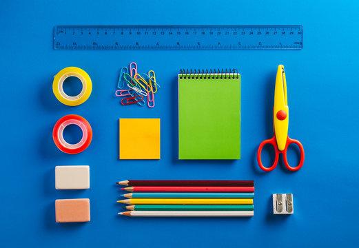 Schools supplies on a Blue Background