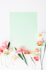 Paper Flowers Arranged with a Green Pastel Background