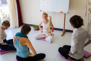 Woman Teaching Anatomy in a Healing Centre