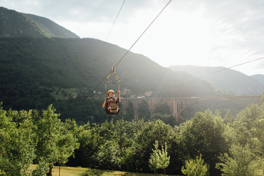 Woman riding on zip line