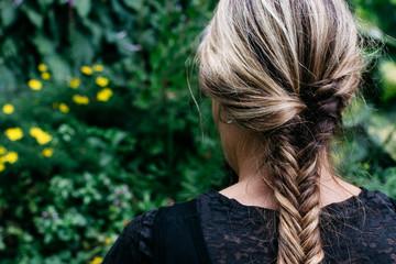 Woman with hair braid in a garden