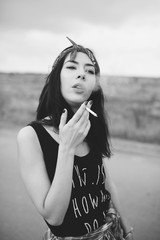 Black and white portrait of a young woman with a cigarette