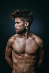 Muscular Shirtless Man in Dark Background