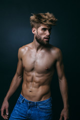 Muscular Shirtless Man in Dark Background