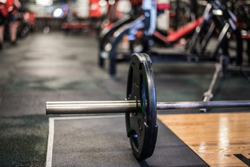 Barbell on ground in gym