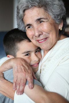 Hispanic Grandma Hugging Grandson