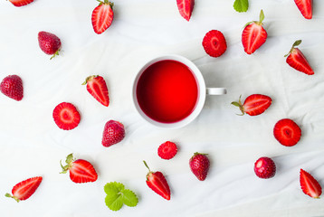 Strawberry tea and fruit flatlay