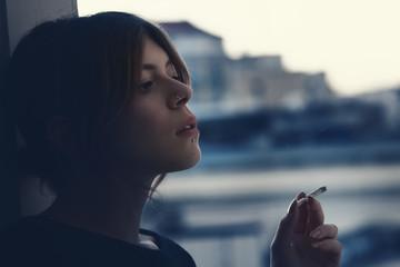 girl smoking a cigarette