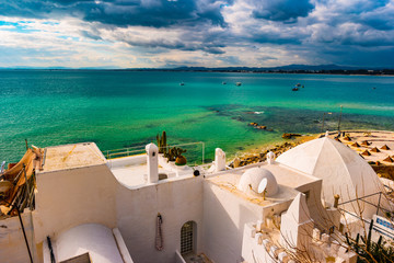 Hammamet, Tunisia. Image of architecture of old medina with dramatic sky at sunset time.