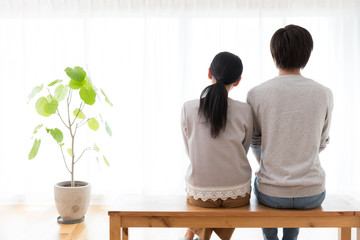 young asian couple in living room