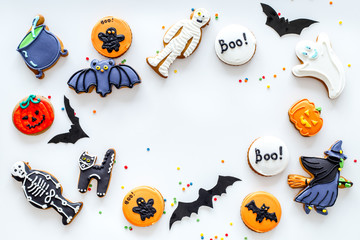 Bright halloween gingerbread cookies frame on white background top view copyspace
