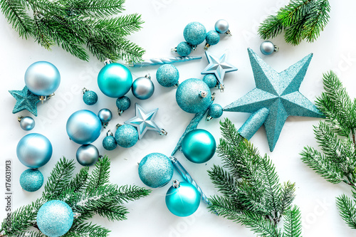 toys for christmas tree blue stars and balls near pine branches on white background top
