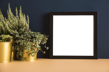 Frame and a plant on blue navy background mock up.