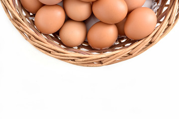 eggs in basket filled isolated on white background.