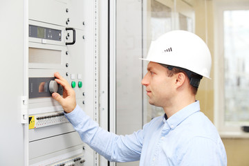 Engineer checking power plant parameters