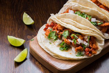 Authentic Mexican tacos with onions, cilantro and lime on wooden surface Wall mural